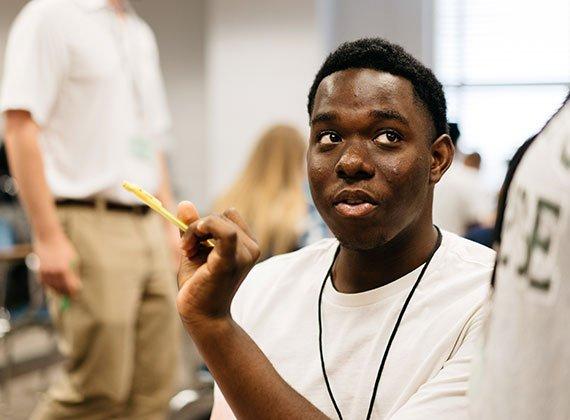 a black student raising his hand